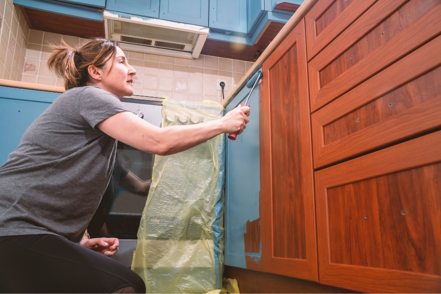 After each light layer of paint sprayed, rolled, or brushed on, lightly sand again and repeat the painting process until you achieve the smooth topcoat finish you're looking for.