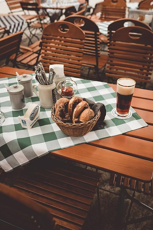 Munich biergarten with pretzels and German beer.