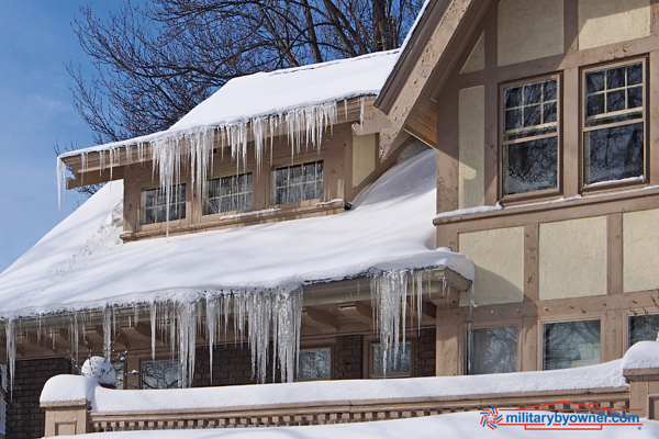 Clean gutters and downspouts as part of your winter home maintenance.