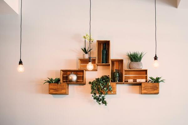 Make use of your walls for apartment decor and storage.