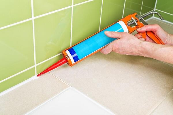 Coordinate with your landlord about repairing bathroom caulking.