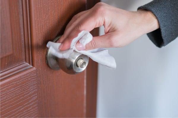 wiping down doorknob