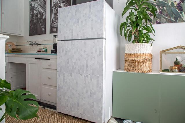 Cover an ugly refrigerator door with patterned wallpaper.