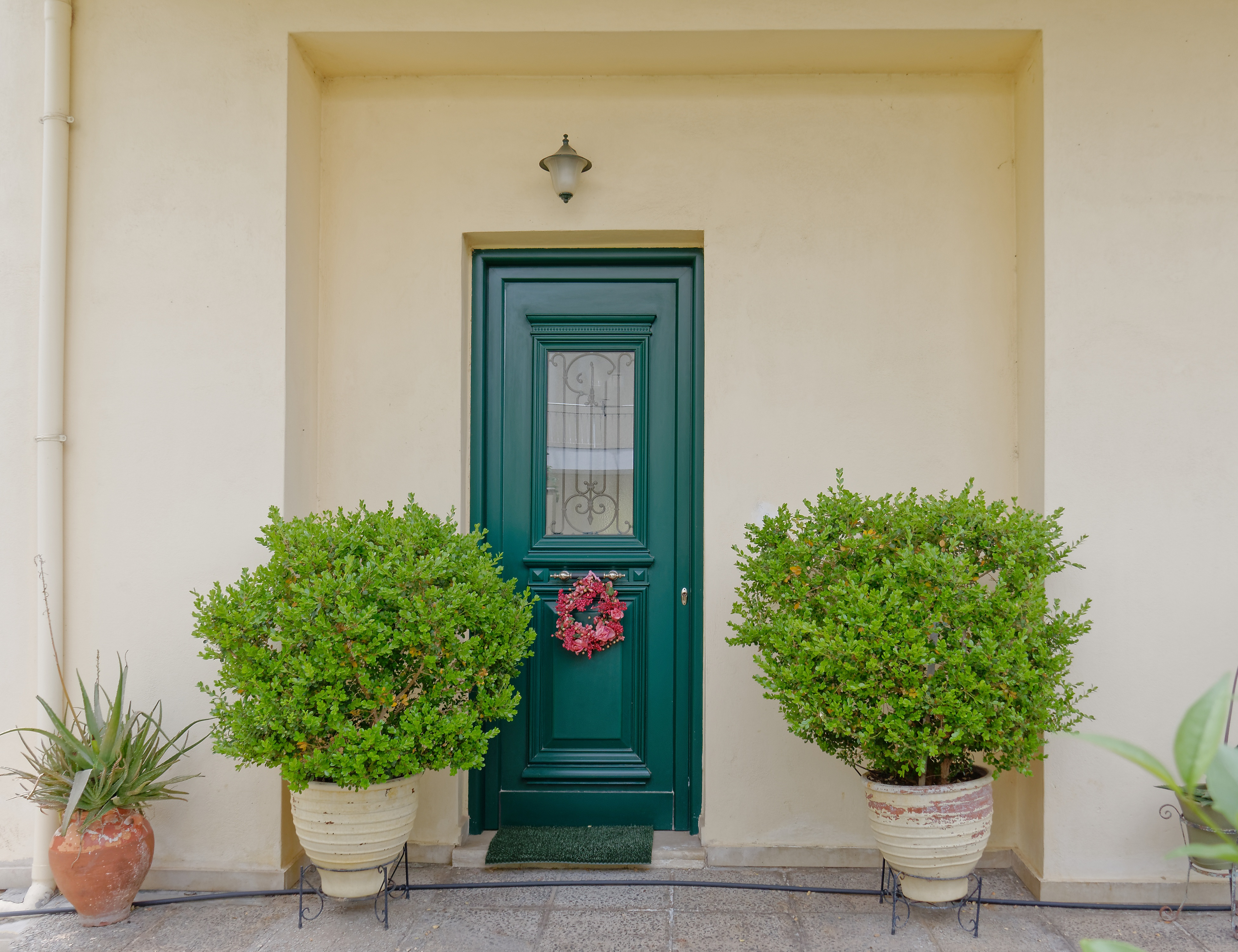 Make over your front door with a shade of green for instant curb appeal.