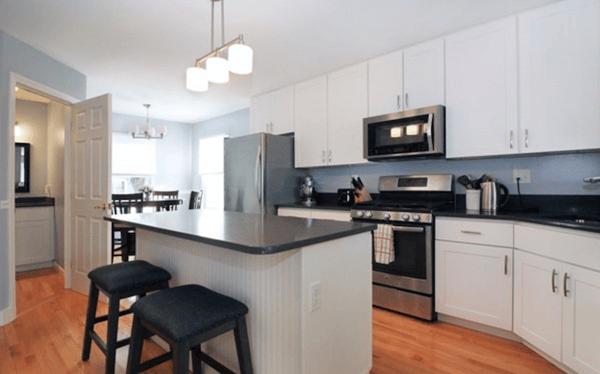 Updated white kitchen in Rhode Island rental home.