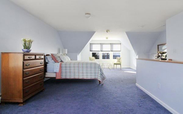 Third floor loft style bedroom in fully furnished Newport rental home.
