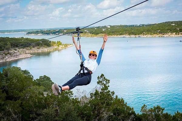 PHOTOS_MIDTOP_LEFT_BIG_lake_travis_zipline_adventures_texas_zip_line_things_to_do_austin_texas_512_outdoor_activities_family_fun_texas_longest_zipline_austin_lake_travis_LTZA_longest_zipline_texas_zip_kid_friendly_