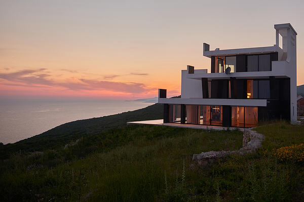 External view of a contemporary house modern villa at  sunset