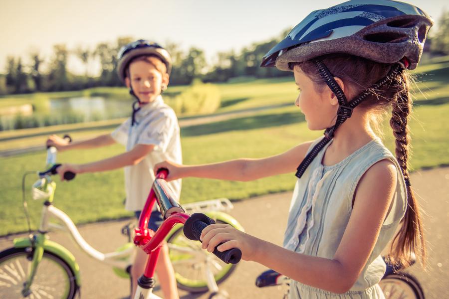 kids riding bikes base housing