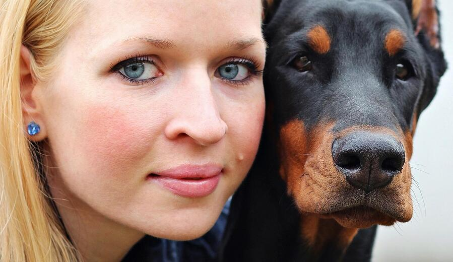 Owner with Doberman