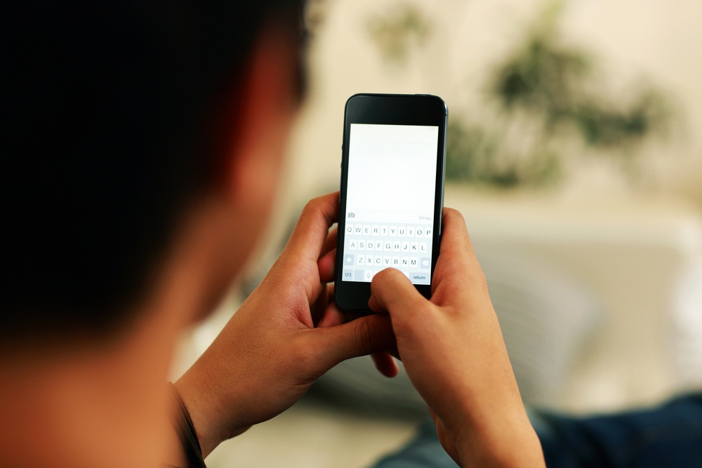 Closeup portrait of a man using smartphone.jpeg