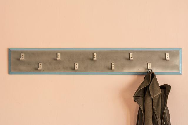 Use hooks and shelving to create more storage space in your garage.