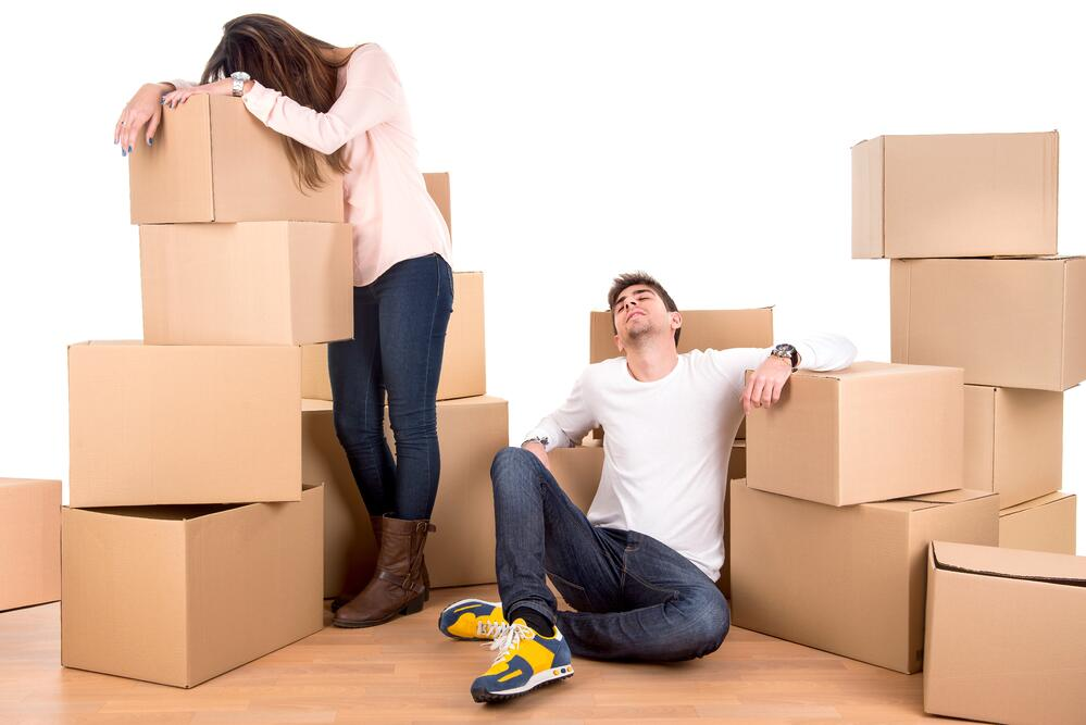 tired_couple_moving_boxes